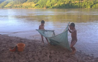 The children were enjoying catching shrimp by using the traditional tool without knowing what will happen if the dam finishes. Thadeua village, Xayabuli province. September, 2015
