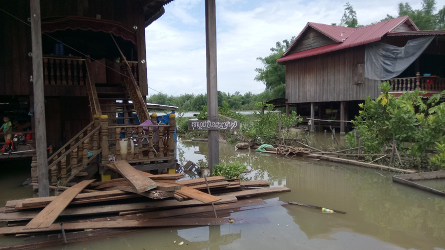 "The sign on the post reads, ""We would rather die than leave our homeland."" Srekor village, Lower Sesan 2 Dam inundation zone"